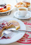 Breakfast including pancakes with raspberry jam Stock Image