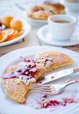 Breakfast including pancakes with raspberry jam Royalty Free Stock Image