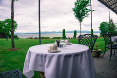 Breakfast at the Inn at Shelburne Farms with beautiful view. Table ready for an enjoyable breakfast at the historic Inn at Shelburne Farms on the shores of Lake Stock Photography