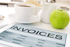 Breakfast and invoices Royalty Free Stock Photo