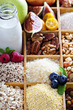 Breakfast items in wooden box. With grains and berries Stock Image