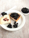 Breakfast - jam with black currants and bread Royalty Free Stock Images