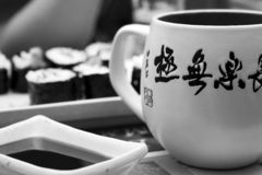Breakfast in Japanese style. With cup with hieroglyphs in black and white royalty free stock photos