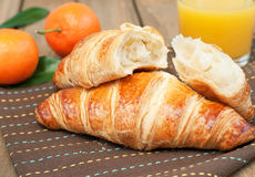 Breakfast with juice and croissant Stock Photos