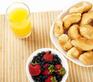 Breakfast juice, croissants and Berries on a table. Light Breakfast: orange juice, croissants and Berries on a table Stock Image