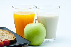 Breakfast with juice, fruit and milk Stock Images