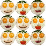 Breakfast for kids. Kids funny meal on white plate. Eggs, parsley vegetables/bread/ketchup is formed by a funny face on a white plate. The concept of food for Royalty Free Stock Photos