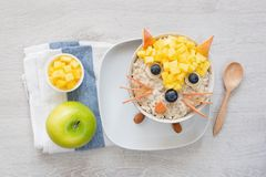 Breakfast for kids, oatmeal porridge with fruits and green apple stock photo