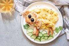 Breakfast for kids - funny sheep scrambled eggs. Breakfast for kids - scrambled eggs with toast look like a sheep Stock Photography