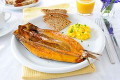 Breakfast Kippers. Fresh smoked kipper with scrambled egg and brown bread royalty free stock photos