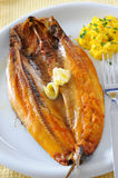 Breakfast Kippers. Fresh smoked kipper with scrambled egg royalty free stock photography