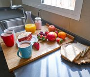 Breakfast in kitchen with coffee bread fruit juice Royalty Free Stock Photos