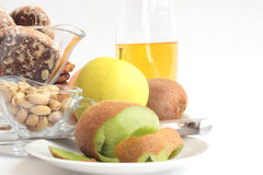 Breakfast. Kiwi, apples, cookies with a peanut, gingerbreads, juice Royalty Free Stock Photography