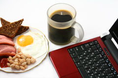 Breakfast with laptop Stock Image