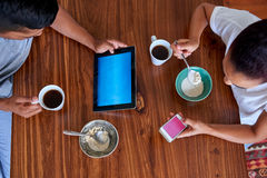 Breakfast lifestyle couple tablet cellphone Stock Photography