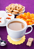Breakfast in lilac tones. White cup of coffee with breakfast items on the lilac textured linen napkin Royalty Free Stock Photos