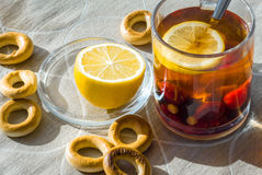 Breakfast. On linen tablecloths worth a cup of tea with berries and lemon Stock Photos