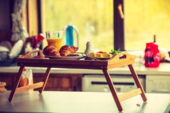 Breakfast on little table, orange juice croissant Royalty Free Stock Photo