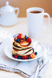 Breakfast, lush pancakes with fresh berries Stock Images