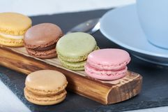 Breakfast of macarons wooden splint stock photo
