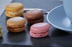 Breakfast of macarons wooden splint royalty free stock photos