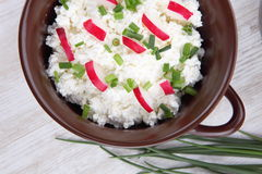Breakfast made from cottage cheese with chive and radish Royalty Free Stock Images