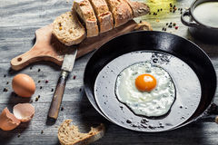 Breakfast made of eggs and bread. On old wooden table stock photos