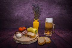 Breakfast man,Family Breakfast. Beer, Pohar, foam, wood, birch, background, alcohol, floor,Product photo.Fotos in the interior with the help of lightning royalty free stock images