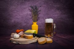 Breakfast man,Family Breakfast. Beer, Pohar, foam, wood, birch, background, alcohol, floor,Product photo.Fotos in the interior with the help of lightning stock image