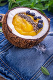 Breakfast mango and berry smoothies garnished with Royalty Free Stock Photography