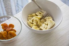 Breakfast: Mashed banana and apricot on table Royalty Free Stock Images