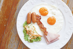 Breakfast meal with ham sausage bacon egg and salad Stock Images