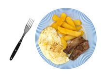 Breakfast meal of steak eggs and potatoes on plate with fork Stock Image