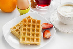 Breakfast meal with waffles and strawberries, fresh fruits , tea Stock Photography