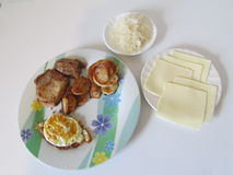 Breakfast(meat, egg, potato, chees slices and sauecraut). Stock Photos
