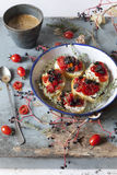Breakfast with mediterranean bruschetta with cherry tomatoes and coffee on cup Stock Photography