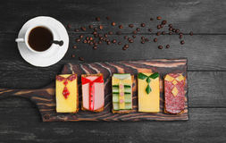 Breakfast for men. Figured sandwiches, coffee. Sausage sandwiches, cheese, vegetables. Concept Breakfast for the day men, father's day, business lunch. Dark Stock Image