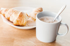 Breakfast menu. Cappuccino with croissant Royalty Free Stock Images