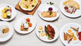 The breakfast menu of different dishes of fried eggs Stock Images