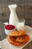 Breakfast with milk and cakes cranberries Royalty Free Stock Image
