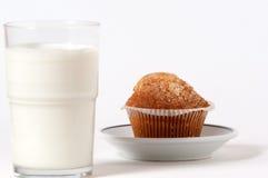 Breakfast milk and cupcake. Focus on cupcake Royalty Free Stock Image