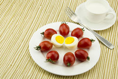 Breakfast milk, egg and tomato, the color is very  Stock Photos