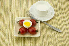 Breakfast milk, egg and tomato, the color is very  Royalty Free Stock Photography