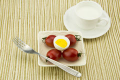 Breakfast milk, egg and tomato, the color is very  Royalty Free Stock Image