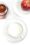 Breakfast with milk, honey and apple Royalty Free Stock Photography