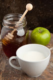Breakfast with milk, honey and apple Stock Images