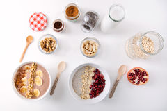 Breakfast with milk and oat, nuts, almonds, banana and pomegranate. Stock Photos