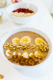 Breakfast with milk and oat, nuts, almonds, banana and pomegranate. Royalty Free Stock Image