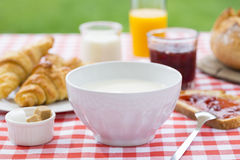 Breakfast with milk, orange juice, croissant, marmalade and brea Stock Images