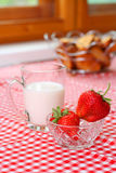 Breakfast with milk and strawberry. On kitchen table royalty free stock images